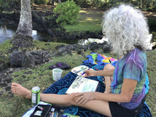 Me sitting painting in Hilo